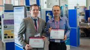 Liam Payne and Peter Martin collect their nuclear innovation awards.