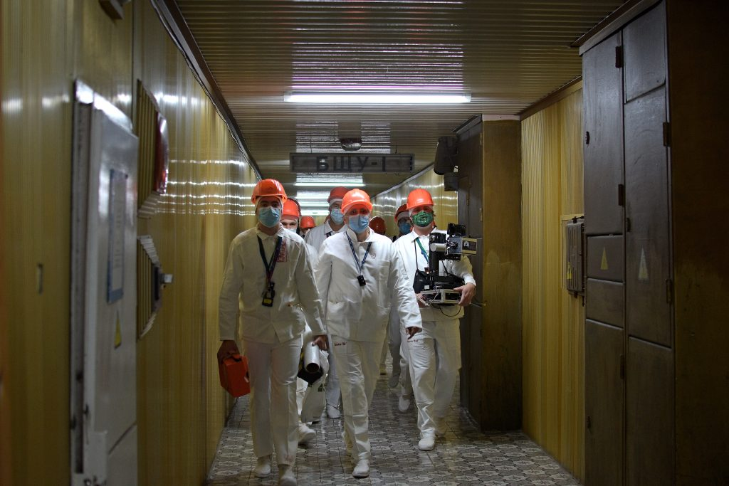Researchers walk down the 'Golden Corridor', which links Unit 4 with the other reactors at the Chernobyl Nuclear Power Plant.